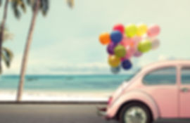 Vintage card of car with colorful balloo