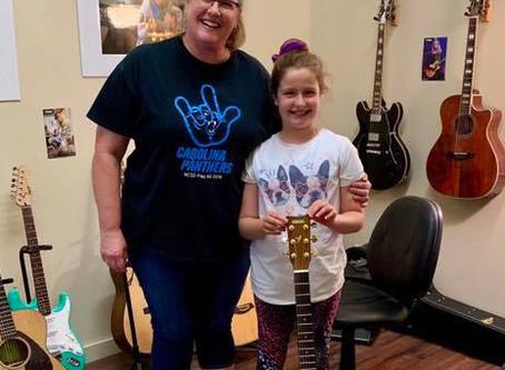 Katrina Earns a Guitar