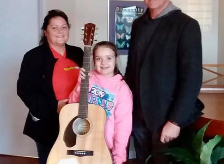 Ashley Earns a Guitar