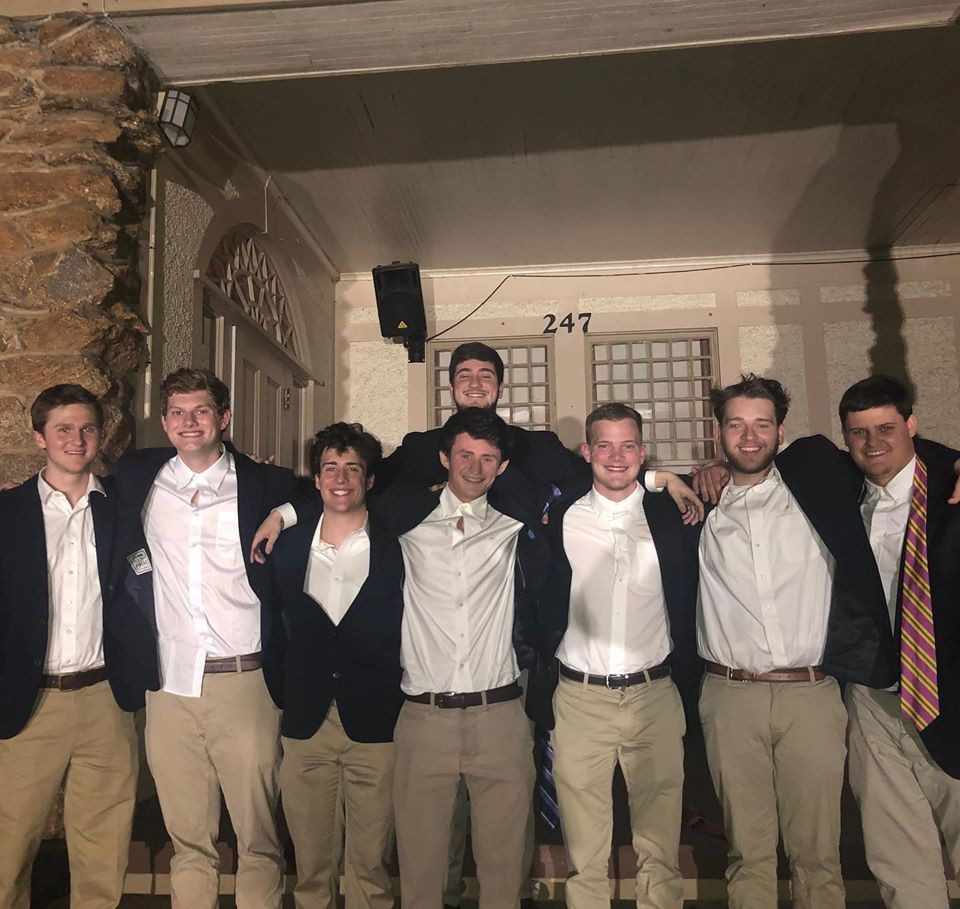 August Hubbard, William Shulstad, Justin Nemetz, Reed Campbell, Sam Johnson, Brian Shaniker, and Brett Hall with their New Member Educator Max Withers.