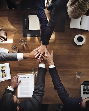 business-people-stacking-their-hands.jpg