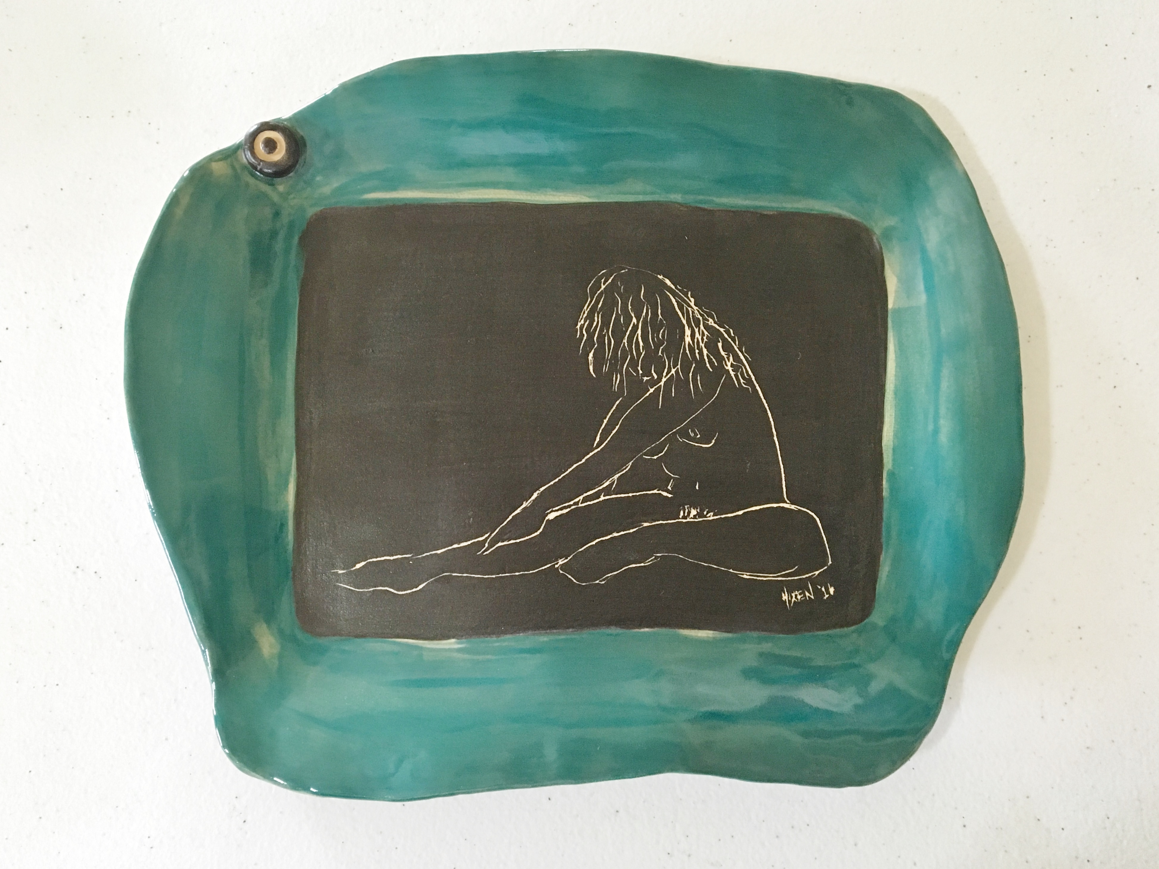 Teal platter with figure