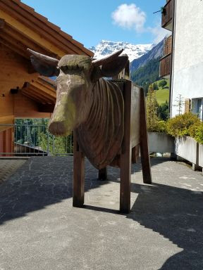 Bull made of water trough and many layers of one-inch-thick wood slabs for a neck ,is very thoughtful and still.