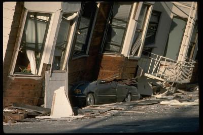 .Homes fallen on car during an earthquake