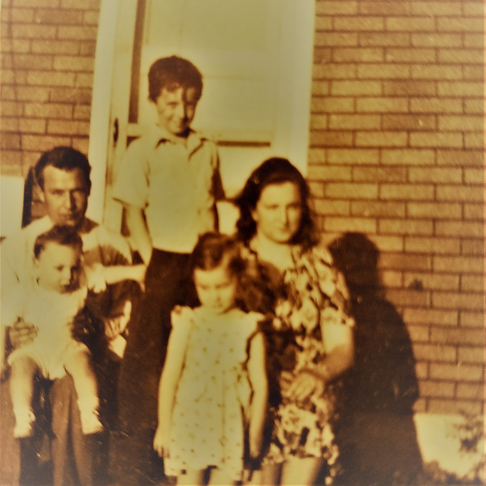 Dad, Al at eight years old, Mom, Jim a baby, and me at three on the back stoop of our old house in Ashland, Oregon