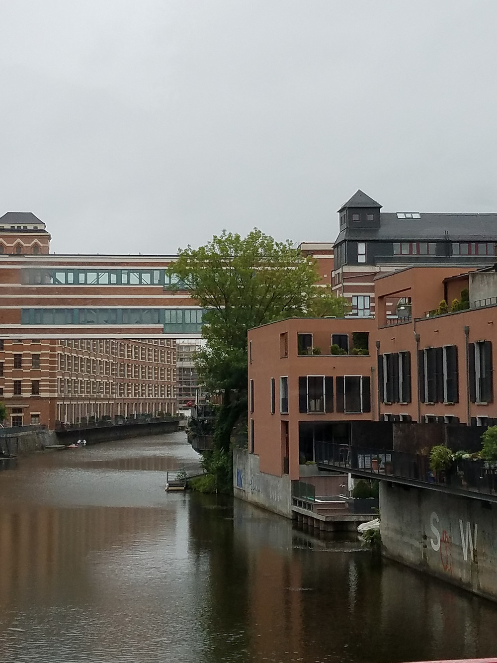 Once warehouses, now affordable housing in Leipzig over Eister Canal[ Richen
