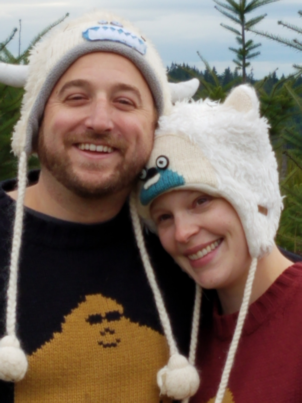 Owyn and wife wearing yeti winter hats and yeti sweaters.