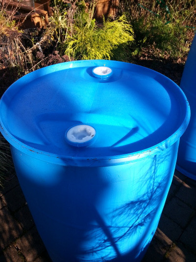Blue barrel for water up close.