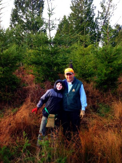Woody and grandson in the grasses of our tree farm.