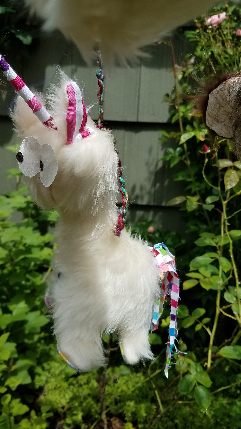 White unicorn with rainbow ears, tail and horn,