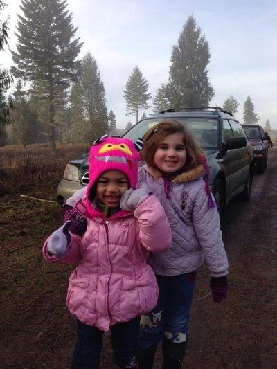 Two grandchildren pretend to be bear and deer as they hike through the woods.