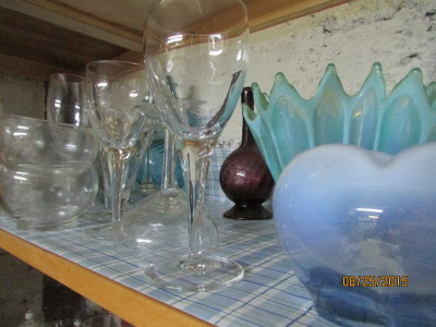 Lots of glass vases and glasses stored in the canning cupboard -- not a good idea.