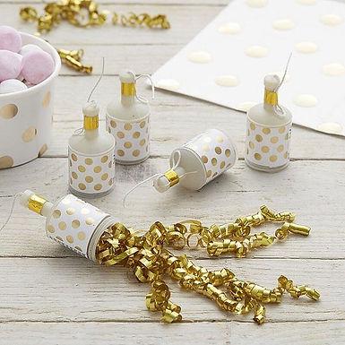 Party Poppers mit kleinen goldenen Luftschlangen