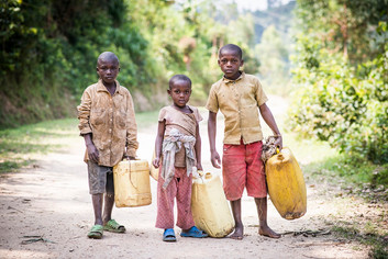 Kids with water containers - Photo credit Nicola Bailey  resize.jpg