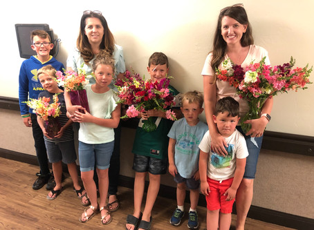 Families sharing flowers and love