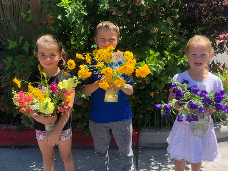 Children delivering flowers makes everyone smile
