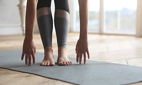 touch toes pilates image.jpg