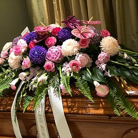 Pink & Purple Funeral Casket Spray