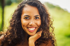 Young African American woman symbolizes feeling happy after counseling