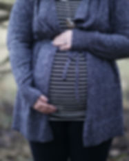 woman-pregnant-in-black-and-white-stripe