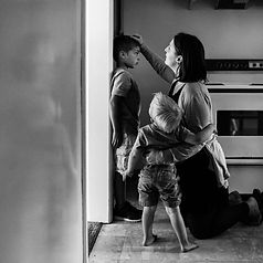 photo-of-mom-measuring-the-height-of-her