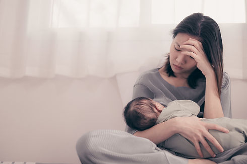 Tired Mother Suffering from experiencing postnatal depression.Health care single mom mothe