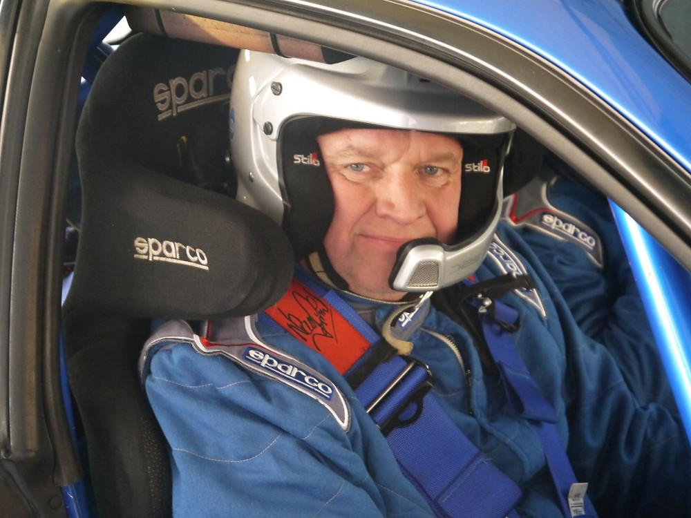 Picture of David White behind the wheel of his Subaru Impreza