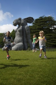 Picture of children playing in front of a sculpture at Yorkshire Sculpture Park