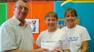 Image of Barnsley Rotary Club handing cheque to Monkey Bay fund