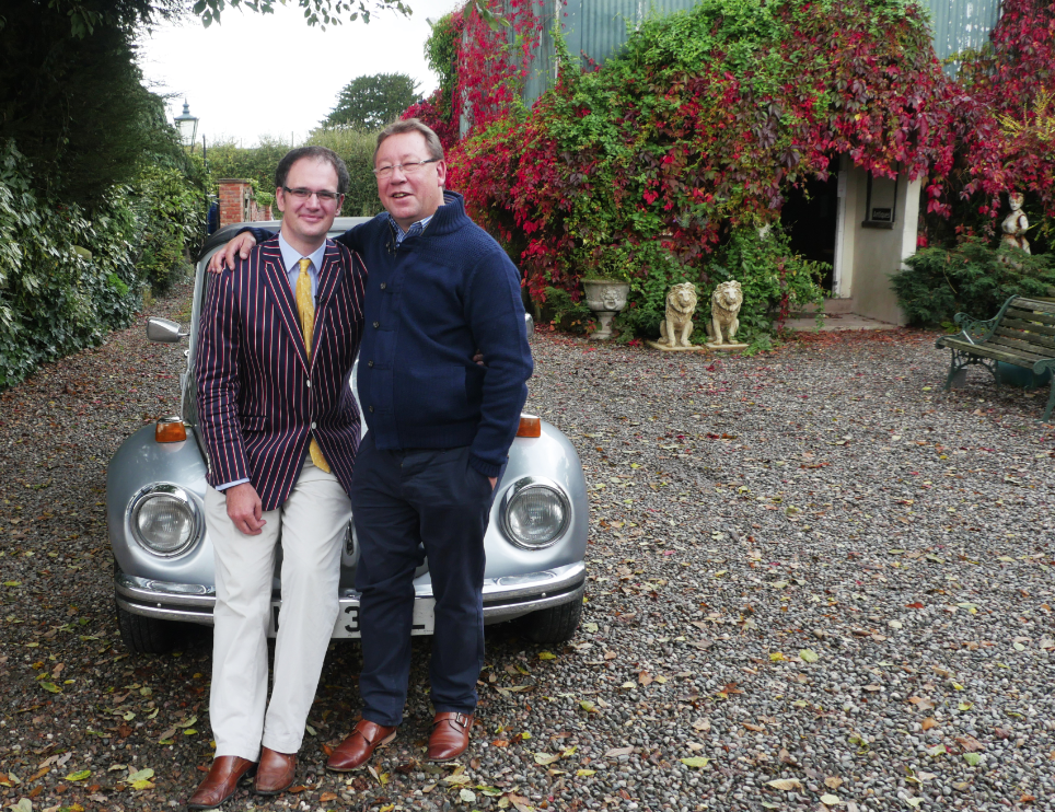 Image of Mark Stacey and Charles Hanson (L-R) beside a silver 1973 convertible VW Beetle vintage car