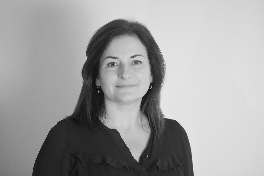 Monochrome portrait photo of Dr. Helen Flaherty