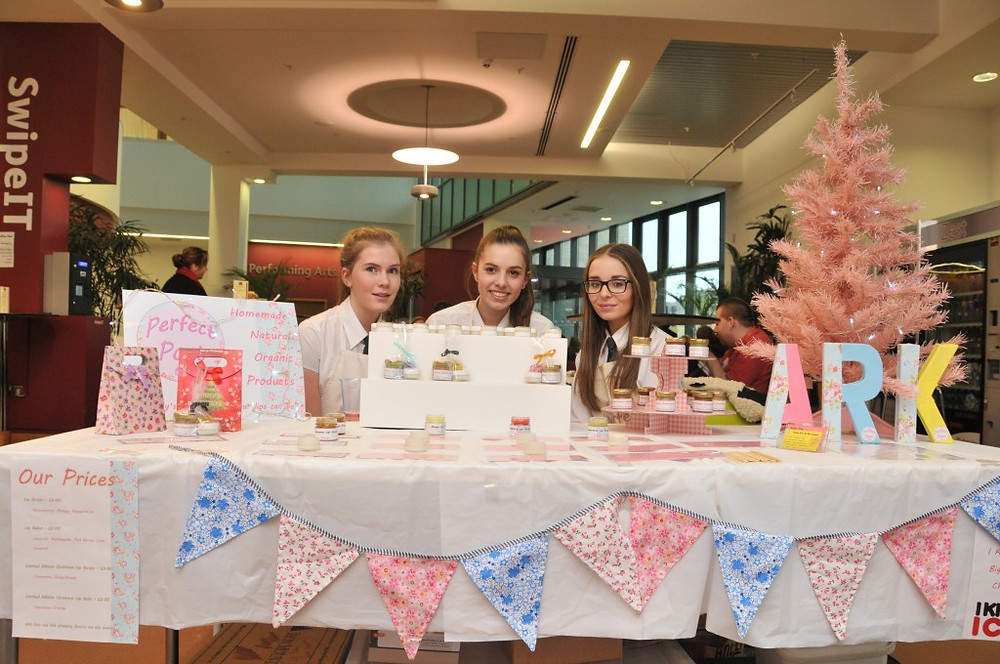 Image of Year 10 pupils on their market stall