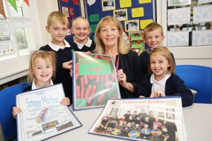 image of Head teacher Sally Kimber with pupils displaying Cornerstones porject work at Marshland Primary School in Moorends, Doncaster