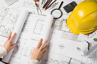 crop-architect-opening-blueprint_23-2147