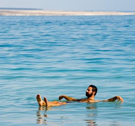 bigstock-Floating-In-The-Dead-Sea-82629503-e1450266853451.jpg