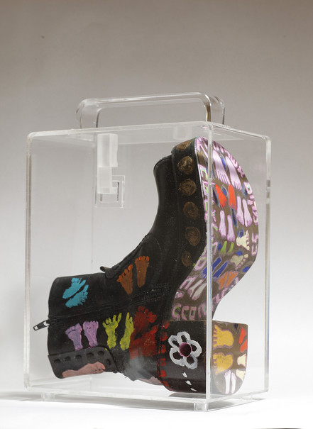 Striding in Purses (2), 2010, mixed media inside a perspex purse