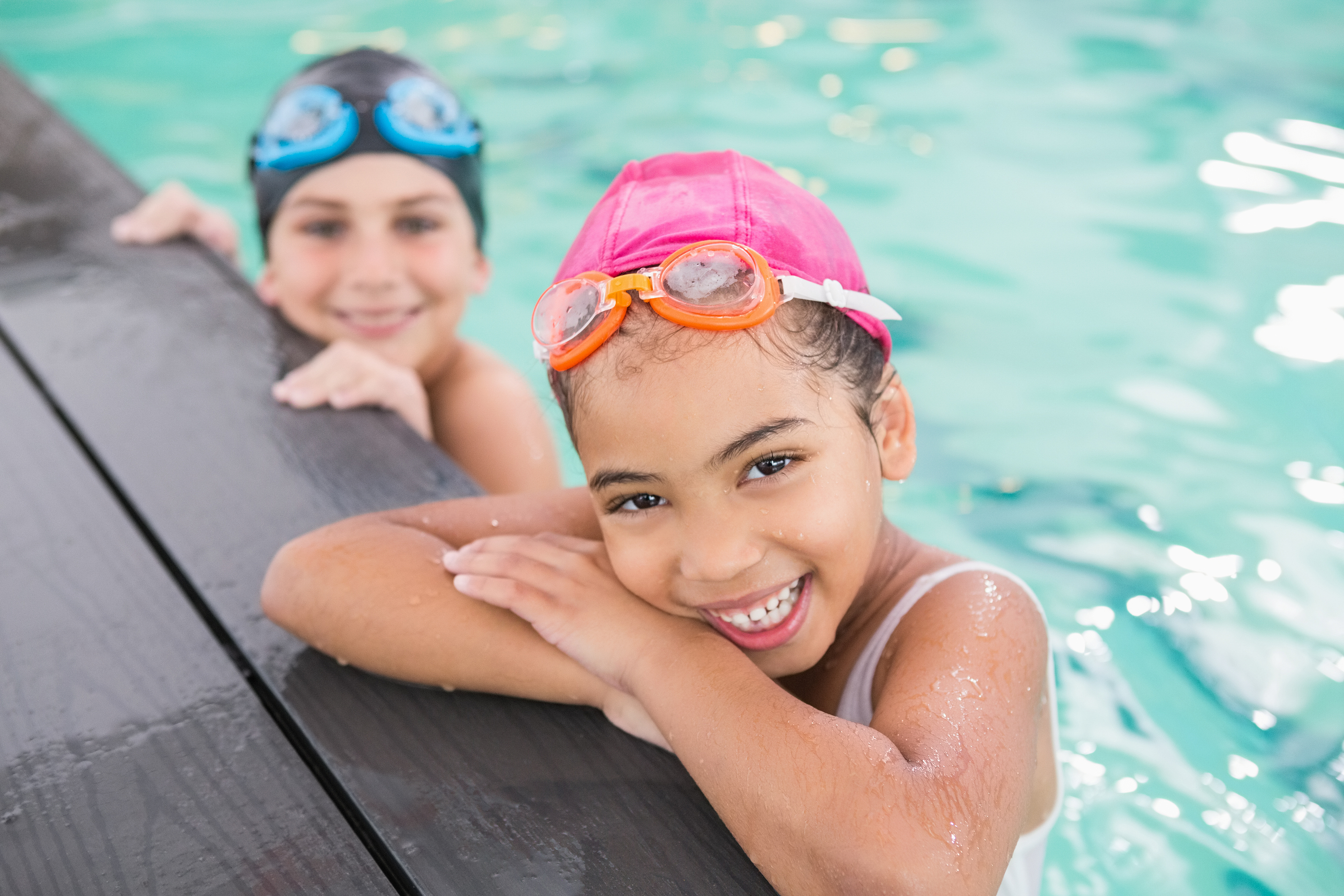 Cute swimming class in the pool at the leisure center.jpg