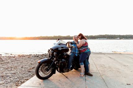 Sunset couples portrait with motorcycle at Illiniwek Park in Hampton Illinois
