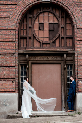 Bride and groom against old building in Peoria, Illinois