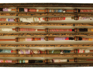 "WRAPPED IN MANY STORIES THREE 2012 27.5"" x 10"" x 3"" —Found objects, wood, fabric, felted wool and buttons."