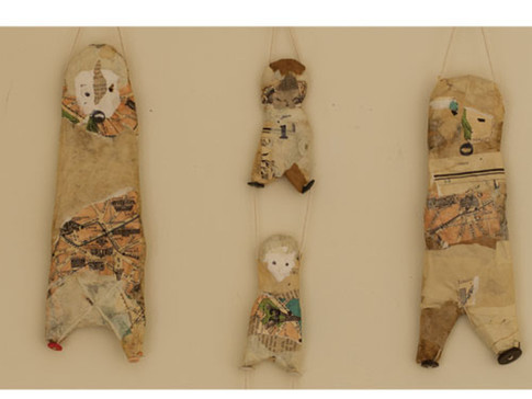 """BALANCE 2010 15"""" x 21"""" x 1.5"""" Paper mache, wood, buttons, and string."""