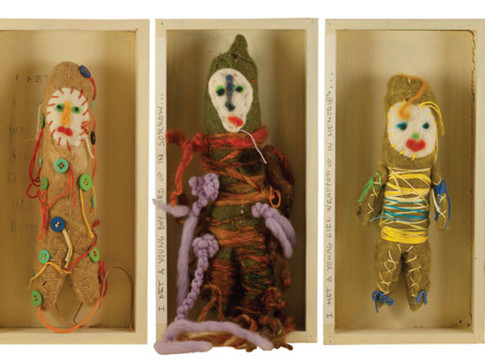 "ALONG MY JOURNEY 2009 25"" X 12"" X 2"" Felted dolls read: ""I met a small man all covered in buttons... I met a young boy tied up in sorrow... I met a young girl wrapped up in memories... I met an old woman speckled with kindness... inspired by Bob Dylan's A Hard Rain is Going to Fall."