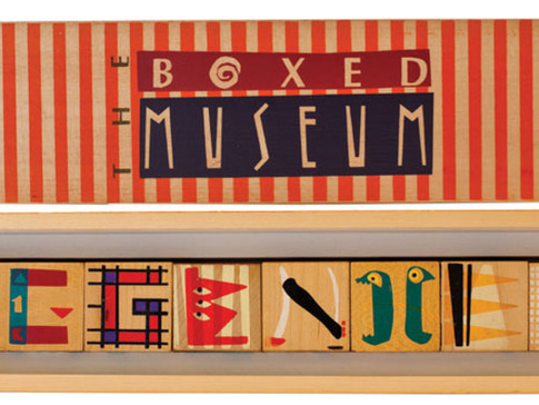 THE BOXED MUSEUM—Designed and produced exclusively for the Guggenheim Museum. The blocks spell Guggenheim in letters designed to reflect major artists in the collection: in no particular order: Frank Lloyd Wright, Klee, Kandinsky, Picasso, Mondrian, and Miro—housed in a finely crafted wooden box.