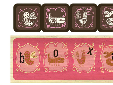 BOX DESIGN OF CURIOUS LITTLE MONSTERS that eat letters that spell Boxart.  Open the box and find chocolates with the letters inside the belly of the monster.