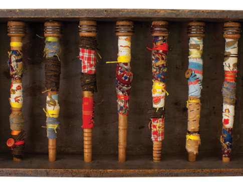 """WRAPPED IN MANY STORIES TWO 2012 9.5"""" x 10"""" x 4"""" —Found objects, wood, fabric, and buttons."""