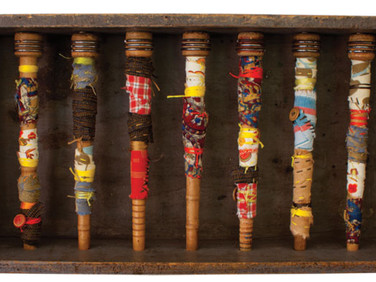 "WRAPPED IN MANY STORIES TWO 2012 9.5"" x 10"" x 4"" —Found objects, wood, fabric, and buttons."