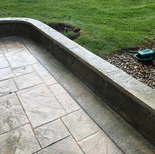 Stamped Patio with stamped wall cap