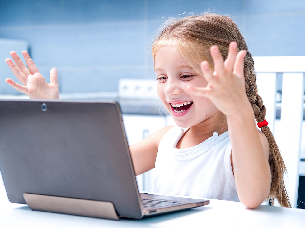 glad little girl with her computer at ho