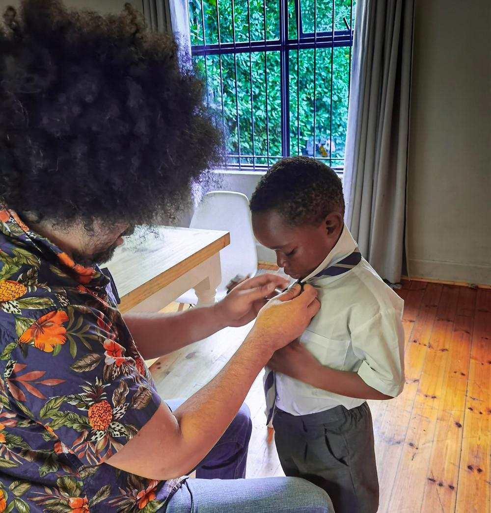 Father tying son's school tie