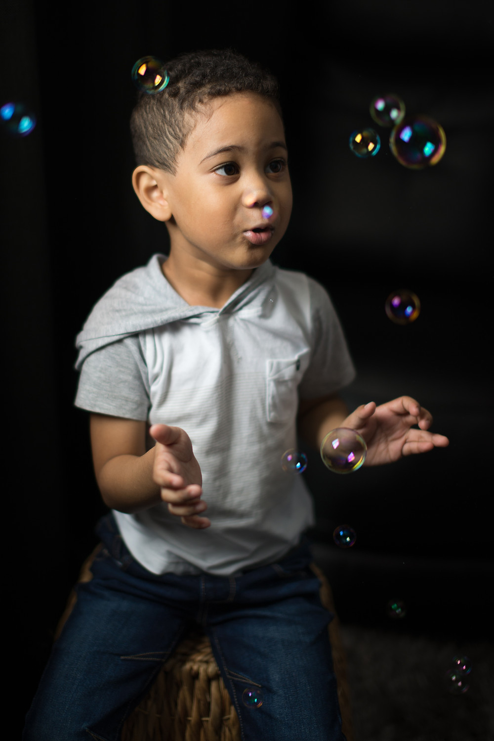 Children photography playing with bubbles